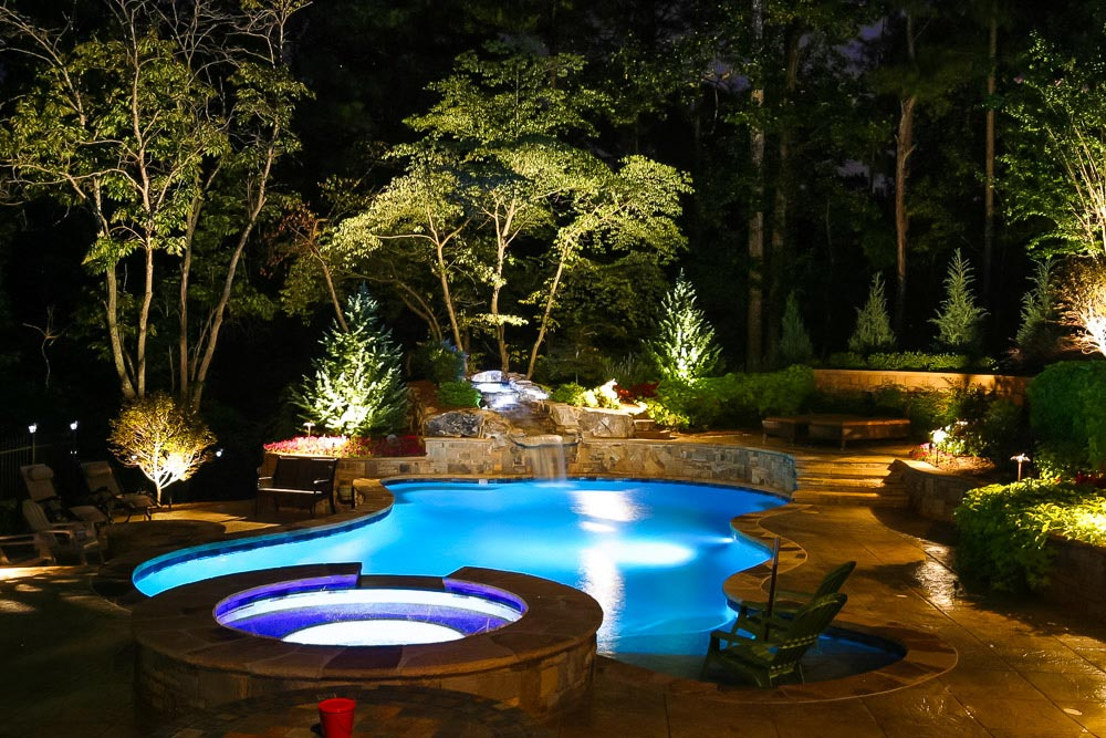 Custom Landscaping with pool and outdoor lighting